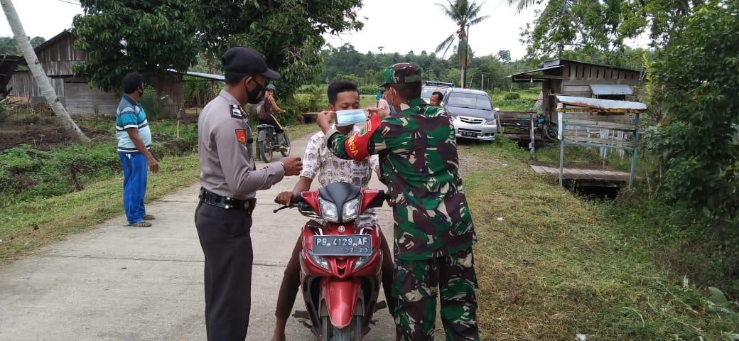 Sinergitas Polsek Salawati Bersama Koramil Salawati Laksanakan Operasi Yustisi